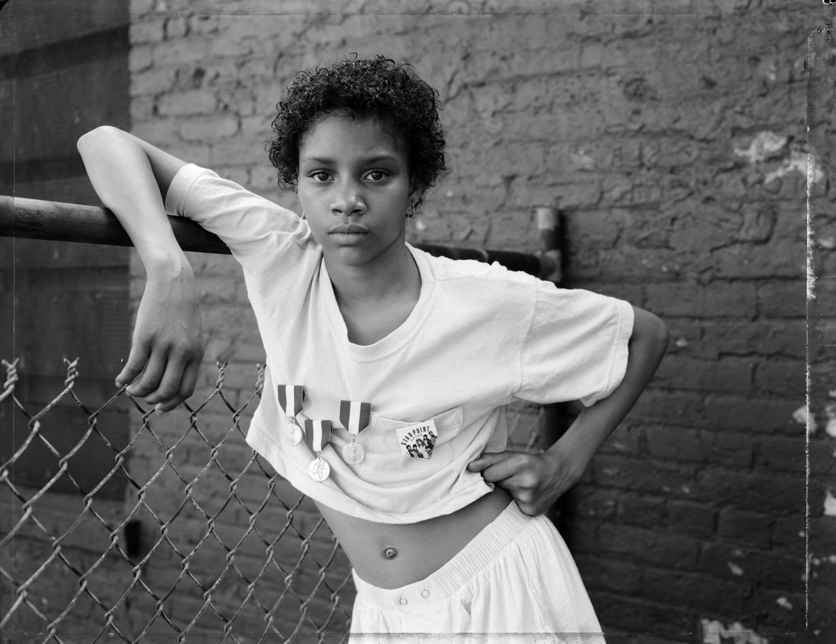 Dawoud Bey, A Girl with School Medals, 1988.